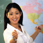 Teacher Pointing at Map of World ca. 2002