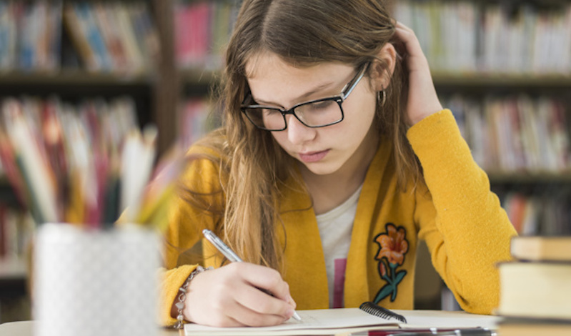 smart-girl-studying-library_23-2147863582