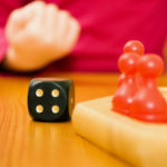 family-playing-boardgame_79405-10672